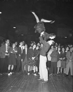 Crowd watching a couple dance in Jitterbug Dance contest Los Angeles, Calif, 1939