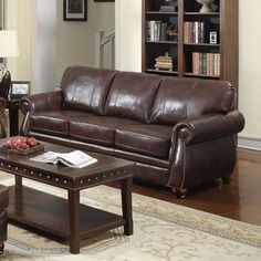 French Welt Design Leather Sofa100 % Top Grain leather - deep Plantation brown - on all seating surfaces|Beautiful leather-match on outside back and outside arms|French welt accents|Distinctive elongated stitch pattern on back cushions|Back cushions removable|Sturdy hardwood/plywood construction w/ Mortise & Tenon joints and corner blocks|Brass-toned nail head trim|Pocketed coil seating for longevity and comfort