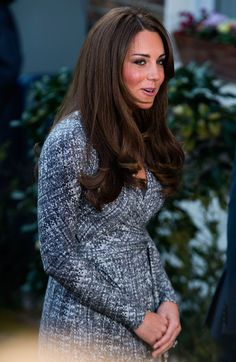 Kate Middleton takes her baby bump public: The Duchess of Cambridge looked radiant in a MaxMara dress, which revealed her tiny baby bump.