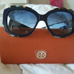 TORY BURCH SUNGLASSES TORY BURCH SUNGLASSES.. blue multi color tortise print.. excellent condition worn maybe 3 times.. comes with case.. Tory Burch ensigna is still covered with plastic.. Tory Burch Accessories Sunglasses