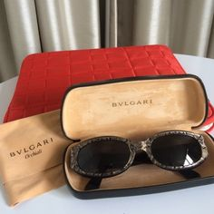 Bulgari sunglasses and case Beautiful Bulgari sunglasses with case and cleaning cloth. Snakeskin look is beige, black. No scratches or damage. Comes from a smoke free home Bulgari Accessories Glasses