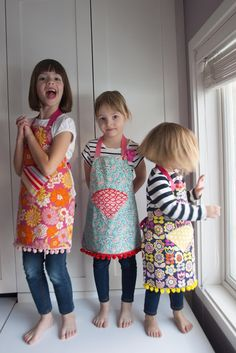 "Aesthetic Nest: Sewing: Child's Reversible Fat Quarter Apron (Tutorial and Pattern) Takes 2 fat quarters, 1 yard of ribbon and a 3/4"" or 1"" button,"