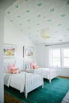 Love the patterned ceiling and pops of pastels.