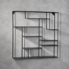 Shop alcove wall shelf. Nine sheet metal ledges suspend and intersect mondrian style on steel rods to frame objects of interest. Raw look with powdercoated finish.