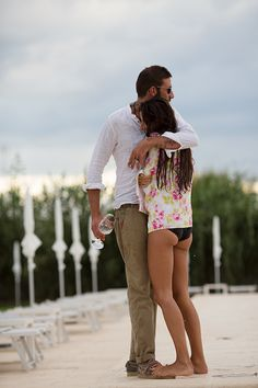 I  love everything about this candid shot. Couple at Wonder Beach Club, Mola di Bari by The Sartorialist
