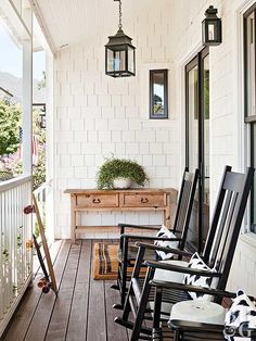 Create a farmhouse porch with casual style, an open design, and cool comfort. Relaxed decor adds style without overshadowing your porch's natural architecture. This porch features black and white rocking chairs, rustic pendant porch lights, and simple farmhouse furniture.