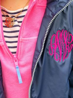 Monogrammed raincoat, vineyard vines pullover and stripes layered with a monogram necklace. So cute