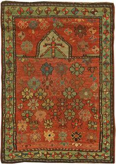 The circa-1920 antique Caucasian rug