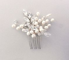 Hey, I found this really awesome Etsy listing at https://www.etsy.com/listing/235301682/bridal-hair-comb-pearl-hair-comb-wedding