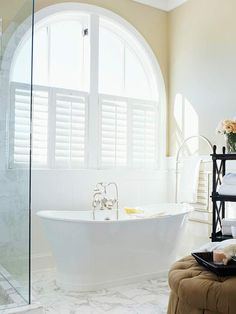Stylish Shutters - Interior shutters on the lower half of the window offer the perfect combination of privacy and sunlight for a bathroom. Cafe Shutters, Interior Shutters, Window Shutters, Custom Shutters, Custom Blinds, Room Window, Dream Bathrooms, Beautiful Bathrooms, Ottoman Decor