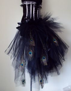 Long black bustle belt made from dress net tulle with Peacock Feathers ribbon bows could be worn at lots of occasions .