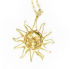 features a sun face pendant on a thin yellow gold chain •  Total chain length: Approximately 16 inches long•  Metal type: Gold Plated Base •  Pendant size, about 0.7