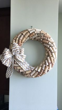 Best 12 This wreath is hand made with wine corks. The bow color can be changed if requested. I can send you different color options as well, if you do want a different bow. Extra bows will have an extra fee attached. Email with any questions Wine Craft, Wine Cork Crafts, Wine Bottle Crafts, Wine Cork Wreath, Wine Cork Art, Cork Christmas Trees, Wine Cork Projects, Wine Bottle Corks, Bottle Candles