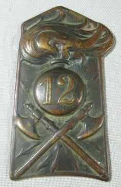 Unusual Antique Bronze Firefighters Uniform Helmet Plaque Badge 12 Fire Grenade