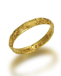 A 17th century gold posy ring  The hoop engraved with elaborate floral motifs, the interior engraved 'love ever or never', indistinct maker's mark