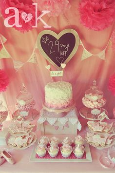 What a great princess dessert table for a sweet baby shower! See more party ideas at CatchMyParty.com. Love the sign that says how many days left. Tissue flowers are cute.