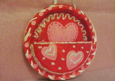 Valentine's Day card holder for kiddies at school.  All you need is two paper plates, a hole punch, and some string or ribbon.