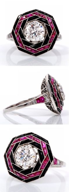 An Art Deco platinum, diamond, ruby and onyx ring. Set to the centre with a round-cut diamond weighing approximately 1.25 carats, within a surround of French-cut rubies and onyx, mounted in platinum. #ArtDeco #ring
