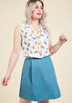<p>By fashioning this ivory top, you express that your effortless style was meant to be! Featuring a bright, colorful print of creatures inspired by the Chinese zodiac, polished with goldenrod trim, and updated to flaunt a more flattering neckline, this ModCloth namesake label top gives your ensemble easy fashion expertise. Lucky you!</p>