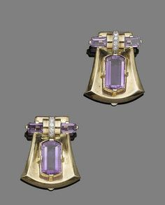A pair of amethyst and diamond clip brooches by Charlton & Co., circa 1935 Each shield-shaped brooch, centrally-set with a fancy-cut amethyst, surmounted by a row of brilliant-cut diamonds between two similarly-cut amethysts, diamonds approx. 0.30ct total, signed Charlton, length 3.6cm