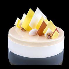 «Vanille -tonka mousse/ mango-passion confit/ hazelnut moellleux…