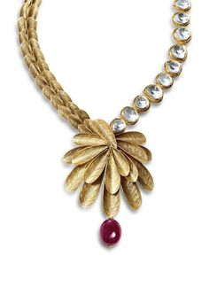 Made with gold, kundan and ruby, this piece of jewelry is sure to evoke awe and envy