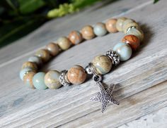 About the Bracelet Calming aqua terra jasper compliments this starfish perfectly for a relaxing beach feel. Bracelet Details: This beach bracelet is made with: ♥ 8mm Aqua Terra Jasper ♥ A silver starf