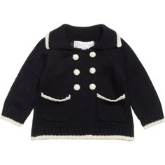 Powell Craft navy blue knitted cardigan worn in family picture first noted November 25, 2014. Our thanks to @hrhGeorgePieces for discovering this item. It's made from soft cotton with ivory trims, two front pockets and wool covered buttons. It is perfect for wearing over tops and babygrows and is thick enough to be worn as a light pram coat