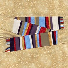 """This free quilt pattern is called """"Striped Scarf Doctor Who Quilt""""."""