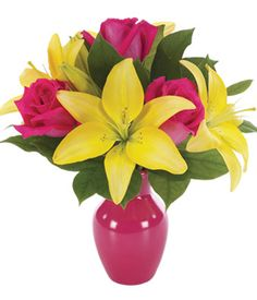 "Summer Bouquet  Brighten her day with a gorgeous array of lilies and roses in a bright bud vase. This beautiful display of flowers is arranged by a local florist and delivered in a hot pink vase to brighten anyone's day. Available for delivery today. Measures 13""H by 10""L.  $52.99 + Shipping http://shop.o2o.com/item.php?LBB-FXc279K1u-24247"