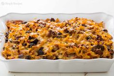 Beef Noodle Casserole Recipe Main Dishes with olive oil, white onion, bell pepper, garlic, crushed tomatoes, ground beef, salt, mushrooms, egg noodles, frozen corn, black olives, cheddar cheese