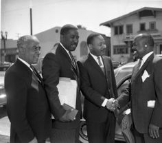 Dr. Martin Luther King Jr. at the Western Christian Leadership Conference, June 17, 1962.  Left to right, Gilbert Lindsay, Ralph Abernathy and Dr. King, with unidentified man. Charles Williams Collection. Institute for Arts and Media Photographs.