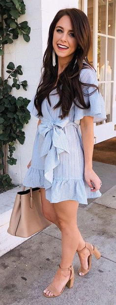 #spring #outfits woman wearing white dress holding brown leather tote bag. Pic by @darylanndenner #dressescasualspring