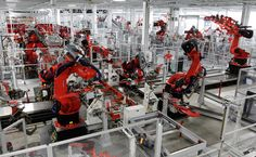 While the many robots in auto factories typically perform only one function, in the new Tesla factory in Fremont, Calif., a robot might do up to four: welding, riveting, bonding and installing a component.