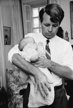 Robert F. Kennedy Holding Son Douglas Senator Robert F. Kennedy holds his infant son Douglas at their Hickory Hill home.                                                   Stock Photo ID:  OUT19443383   Date Photographed:  1967