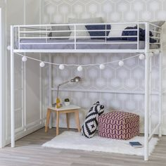 So much room for activities! With this lovely loft bed, you can instantly open up your little one's room while also adding high style. Taking on a streamlined silhouette, its simplistic frame is crafted of metal with slatted panels and a solid finish that helps it effortlessly adapt to any setting. Keep the bed up top equally chic and cozy with a sumptuous white comforter dotted with plush patterned pillows and tassel-trimmed throw blankets, then occupy the space below for a casual spot t...