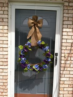 grapevine wreath with hydrangea and burlap bow. supplies bought at Michael's  craft store!