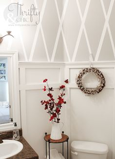 Thrifty and Chic - Love the X pattern stripes on the wall