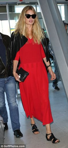 The lady in red: The blonde beauty certainly put on a bold display as she navigated the departures lounge