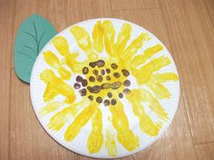 Preschool Crafts for Kids*: Easy Paper Plate Sunflower Craft- Fun and easy for even 2 year olds,we used sunflower seeds in the middle instead of brown paint. ACU