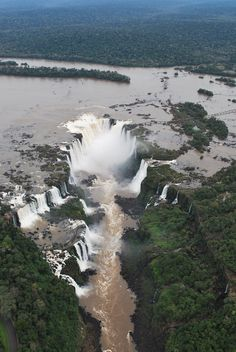 """Cataras de Iguazu are waterfalls of the Iguazu River on the border of Brazilian state Paraná and Argentine province Misiones. The falls divide the river into the upper and lower Iguazu. The falls, twice as wide as Niagara Falls and taller. The surrounding jungle is blanketed by mist, and rainbows shimmer above."""