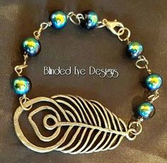 Peacock Feather Charm Bracelet by BlindedEyeDesigns on Etsy