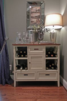 A small bar tucked into the corner holds stemware, wine and other entertaining essentials. Wine buffet: Marshall's; lamp: Target