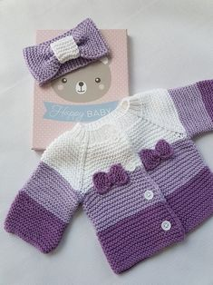 Cardigan and bow for baby worked in garter stitch, using shades of purple. - - Cardigan and bow for baby worked in garter stitch, using shades of purple. – Cardigan and bow for baby worked in garter stitch, using shades of purple. Baby Knitting Patterns, Knitting For Kids, Baby Patterns, Crochet Patterns, Free Knitting, Crochet Baby Clothes, Baby Girl Crochet, Baby Blanket Crochet, Crochet Baby Jacket