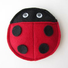 Games: (1) Throw the bean bags into terra cotta pots with pinwheels for a fun toss game (2) Bug hunt with plastic ladybugs (3) Bubble station (4) Pin the spots on the ladybug (5) Golf game (with ladybug standing on its legs)