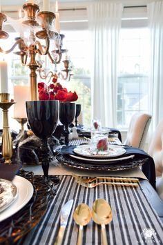 Gothic Dinner Party Halloween Table Ideas with Lots of Candles and Roses