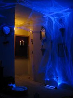 Halloween hallway, glow in the dark purple spider webs with black lights.