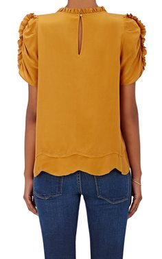 Ulla Johnson Isle Silk Top | Barneys New York  Cut from mustard silk crêpe de Chine, Ulla Johnson's Isle top is embellished at neck, yoke, and sleeves with picot-edge ruffles.    Jewel neck. Front shoulder yoke. Short sleeves. Goldtone button.  Keyhole button-and-loop closure at back.  Available in Goldenrod (mustard).  100% silk. Dry clean. Imported.  $325