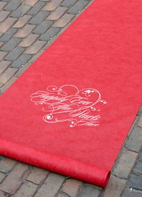 "Your ""happily ever after"" begins as you walk down the aisle on this beautiful red aisle runner. Style DBK30051. #davidsbridal #redweddings #decor #weddings"