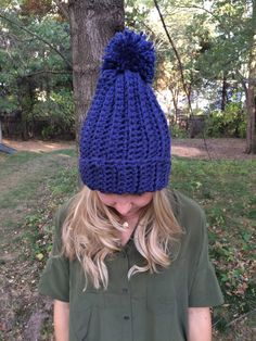 Handmade crocheted hat can be worn with it folded up or down. Can be ordered with or without a Pom Pom. Made with a chunky yarn for thickness.